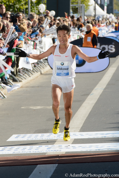 Suehiro Ishikaw crossing the finish line at the Berlin Marathon