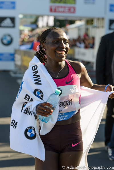 Florence Kiplagat, Women's winner of the Berlin Marathon, after crossing the finish line