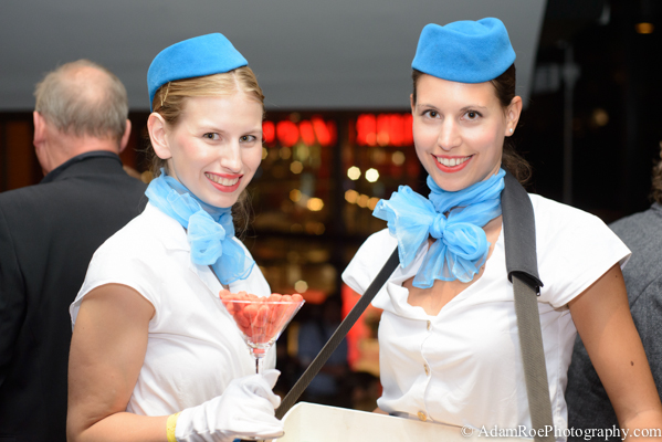 Pan Am flight attendants handing out candy in a martini glass