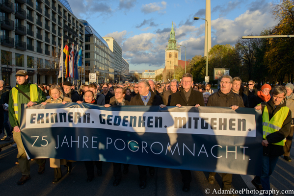 """Remeber. Commemorate. March."" reads the banner held by the Mayor, Protestant Bishop and Catholic Archbishop of Berlin along with other leaders."