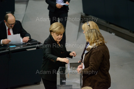 Angela Merkel puts her ballot in the box in the vote for Chancellor in the Bundestag