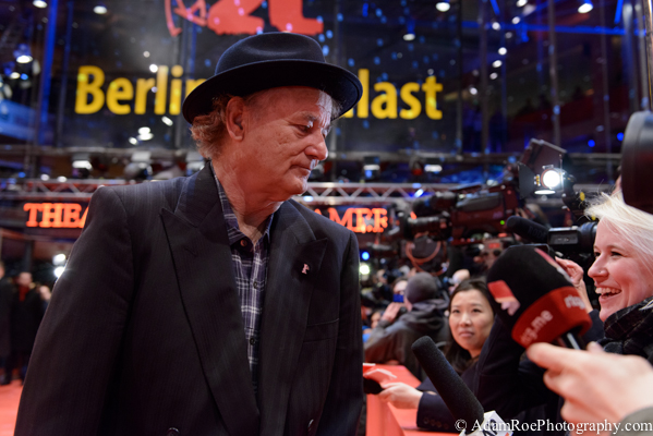 Bill Murray chats with a TV crew on the red carpet at the premiere of Monuments Men. Changing his hat every time and always having fun, Murray was certainly a media favorite this time around.