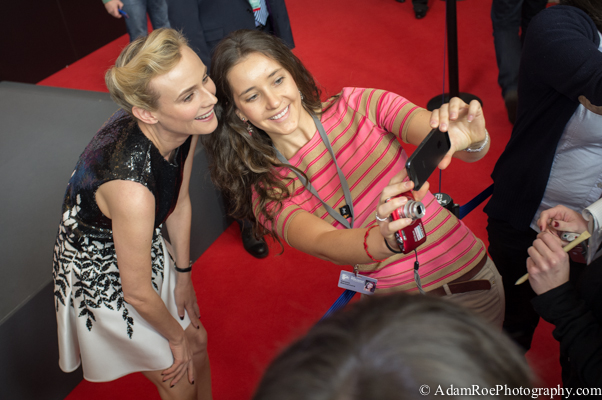 Diane Kruger poses for a selfie with a fan after the press conference for The Better Angels. Overhead shot with a Fuji X100.
