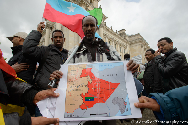 A protestor holds up a map of Oromia and its sorrounding region.