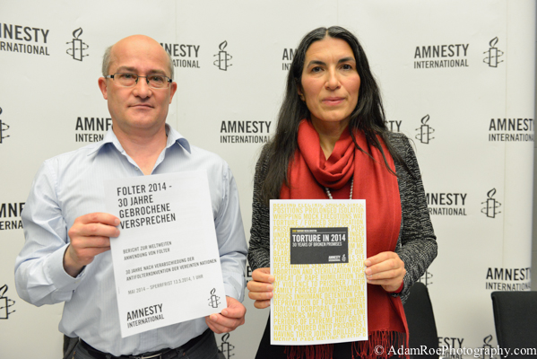 Matthias Polifka and  Selmin Caliskan with the campagin information and 2014 report on torture.