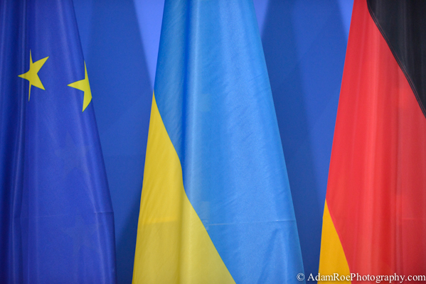 The flag of the Ukraine neatly sandwiched in between the European flag and the German Flag.