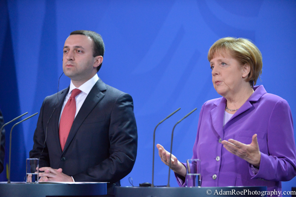 Angela Merkel speaks while Irakli Garibashvili, the Prime Minister of Georgia, listens.