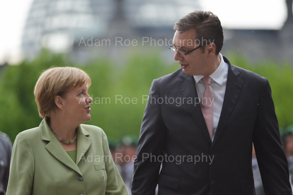 Angela Merkel and Aleksandar Vucic have chat at the reception.