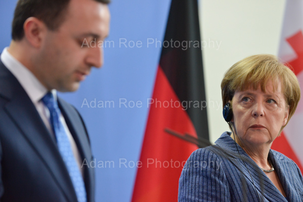 Merkel listens carefully and looks sceptical as Garibashvili speaks.