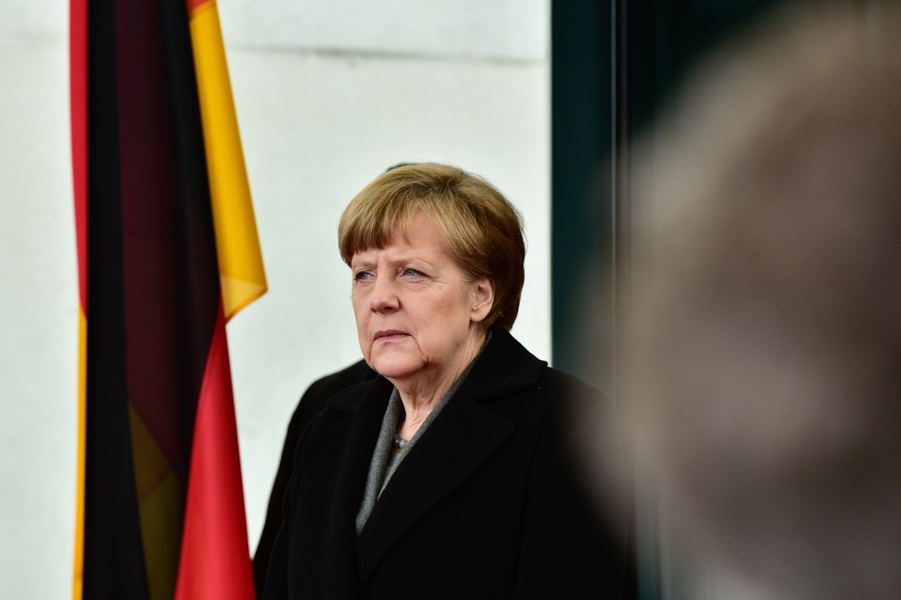 Angela Merkel waits for Francois Hollande at the Federal Chancellery in Berlin.