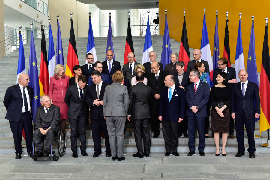 First Row (left to right): Michel Sapin, Wolfgang Schäuble, Emmanuel Macron, Sigmar Gabriel, Angela Merkel and Francois Hollande (backs to camera), Bernard Cazeneuve, Thomas de Maiziere, Fleur Pellerin, Olaf Scholz