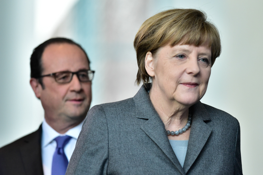 The happy duo of Merkel and Hollande stroll to their press conference together.