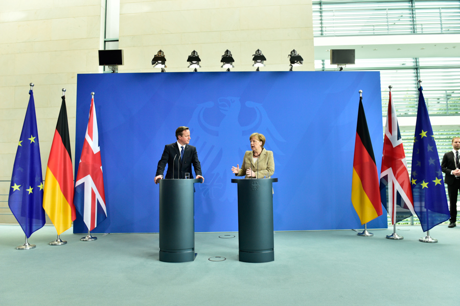 Angela Merkel and David Cameron chatting amongst the Union Jack, the German  flag and yes, the EU's stars.