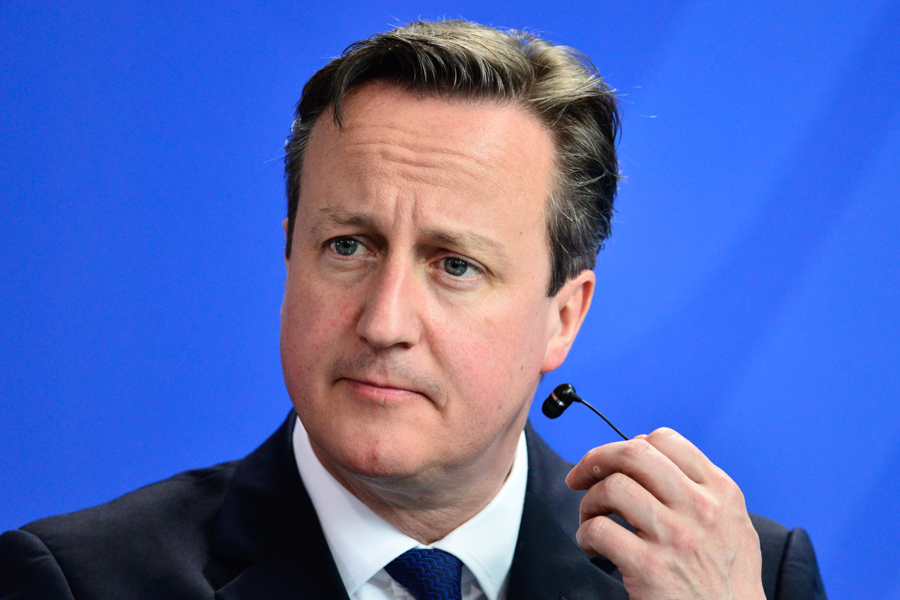 David Cameron having a slight earpiece malfunction.