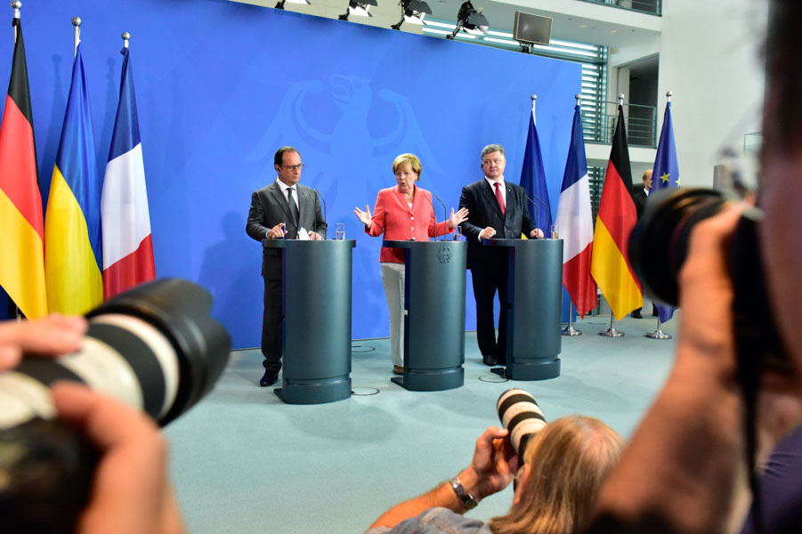 The Big Picture: Francois Hollande, Angela Merkel, Petro Poroshenko. And some colleagues' lenses.