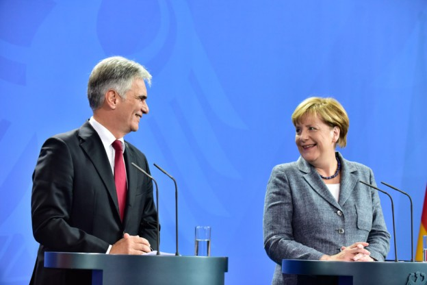 Merkel and Faymann, chatting like old friends. He actually used the informal, Du, and called her Angela!